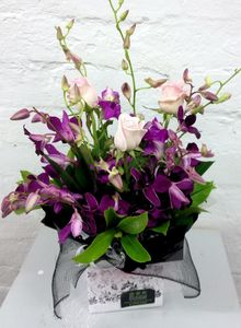 A mini Box of orchids and Roses